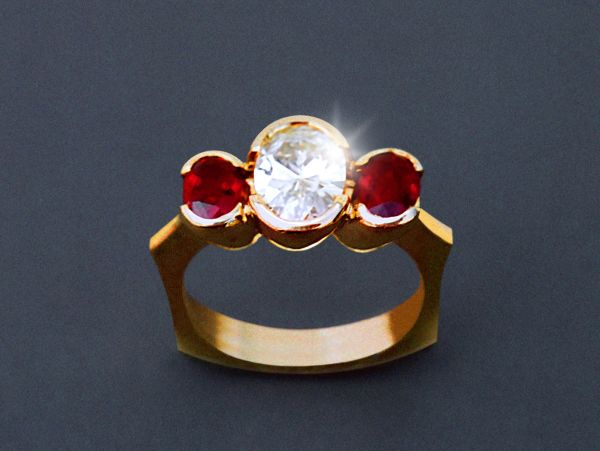 Custom ring in 18K yellow gold with 2.25 ct. oval brilliant diamond and two matching oval fine Burmese rubies