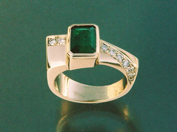 Handmade in yellow gold and bezel set with Brazilian emerald and bead set with round brilliant diamonds