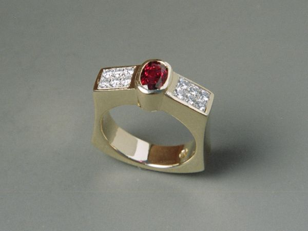 Handmade in yellow gold, bezel set with oval Rubelite tourmaline and pave set with round brilliant diamonds in platinum