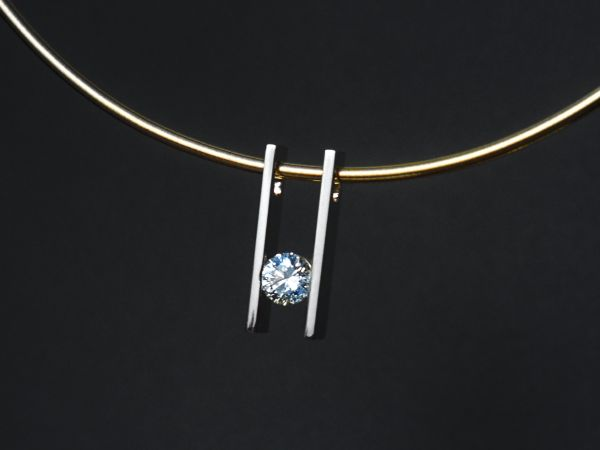 Hand fabricated in yellow gold and channel set with 1 ct. round brilliant diamond