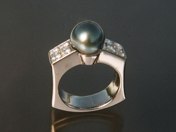 Handmade in palladium and set with a Tahitian black pearl and pave set with round brilliant diamonds